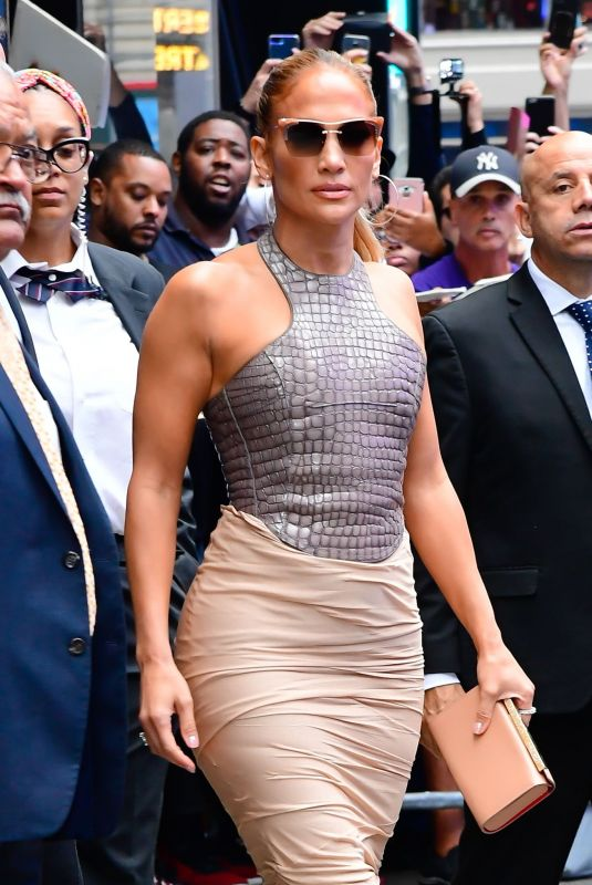 Jennifer lopez in a tom ford lilac embossed top and nude ruched pencil skirt leaving good morning america show in new york