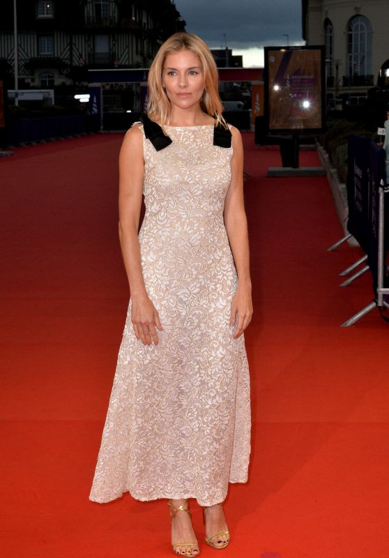 Sienna miller in a white and gold lace chanel dress at the premiere of  american woman  at deauville 2019   2